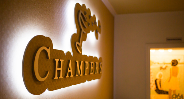 champers sign by the reception desk